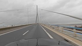 Driving over the Normandy bridge to Le Havre - France stock video footage