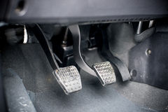 Driving pedal with a manual transmission. Three driving pedal with a manual transmission royalty free stock photography