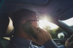 Driving and Phone Talking Royalty Free Stock Images