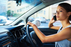 Driving phone woman royalty free stock photo