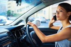 Driving phone woman Royalty Free Stock Photo