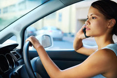 Driving phone woman Royalty Free Stock Image