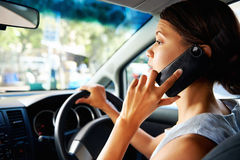 Driving phone woman Royalty Free Stock Photography