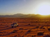 Driving a pickup truck in the middle of Wadi Rum desert in Jordan royalty free stock photography