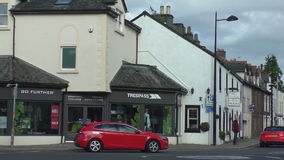 Driving in picturesque English town stock footage