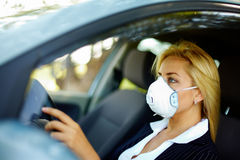 Driving in polluted zone Stock Images