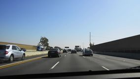 Driving POV through the 405 freeway stock video footage