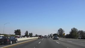 Driving POV through the 405 freeway stock video