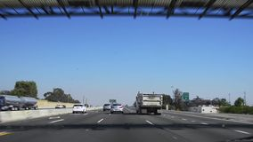 Driving POV through the 405 freeway stock footage