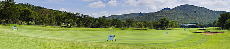 Driving Practice - Panoramic. Marker boards indicating the yardages from the tee off points. Ranging in 50 yard increments all the way up to 300 yards Stock Photos