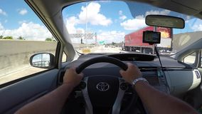 Driving a prius stock video