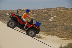 Driving Quadbike Stock Photography