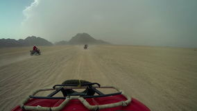 Driving in quadro motorcycle over desert in Egypt stock footage