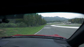 Driving on the racing track from a co-drivers seat stock video footage