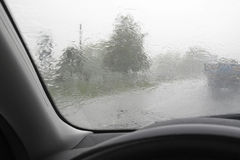Driving in The Rain. With car Royalty Free Stock Image