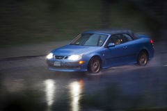 Driving in the Rain. A motion blur of a car driving at night in the rain Royalty Free Stock Photos