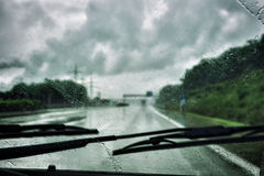 Driving in the rain. Driving car in the rain Royalty Free Stock Photography
