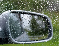 Driving in rain Royalty Free Stock Images