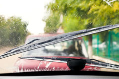 Driving in rain. Car wipers wash windshield when driving in rain Stock Photos