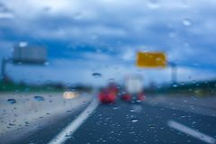 Driving in the Rain, drivers view. From car, out of focus, highway Stock Photography