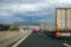 Driving in the Rain, drivers view. From car, out of focus, highway Royalty Free Stock Images