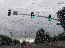 Driving in the rain with many water drops in the glass Royalty Free Stock Photography
