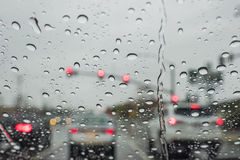 Driving in the rain with many water drops in the glass Royalty Free Stock Photos