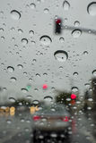 Driving in the rain with many water drops in the glass Royalty Free Stock Photo