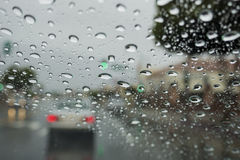 Driving in the rain with many water drops in the glass Stock Image