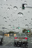 Driving in the rain with many water drops in the glass Stock Images