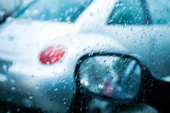 Driving in a rain and traffic jam Royalty Free Stock Photos