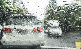 Driving in the rain. On traffic jam Stock Photos