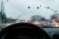 Driving in the rain. Traffic view (view of a car driver Royalty Free Stock Photos