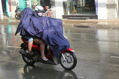 Driving in the rain, Vietnam Royalty Free Stock Photography