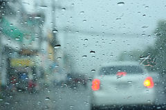 Driving in rain. View from car, Driving in rain Royalty Free Stock Photography