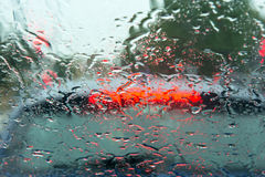 Driving rain. On the windscreen of a car. Taken from inside the vehicle when it was stopped at traffic lights Royalty Free Stock Photography