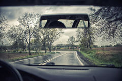 Driving  on a rainy day Stock Images