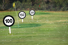 Driving Range. Golf balls, flags and signs at a driving range Stock Images