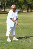 Driving Range 4. Photo of my mother-in-law hitting some golf balls at the golf course royalty free stock photo