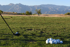 At the driving range. Club and balls at the driving range with mountains as background Stock Photos