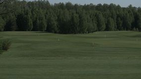 Driving range on the golf course stock video footage