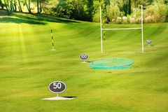 Driving range at golf course with yard signs Royalty Free Stock Images