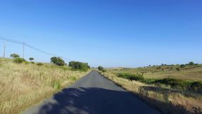 Driving on a Road in Countryside stock video footage