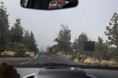 Driving road into the fog royalty free stock photography