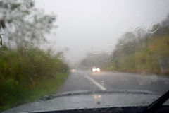 Driving on the road during the rain. Royalty Free Stock Images