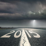 Driving on road towards the storm to 2015 Stock Photography