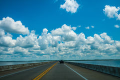Driving on road with water Royalty Free Stock Photography