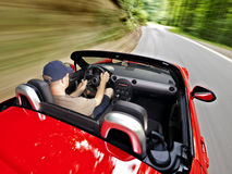 Driving roadster Royalty Free Stock Photos