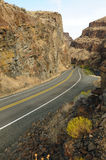 Driving through rock gorge Royalty Free Stock Images