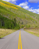 Driving in the Rocky Mountains with Autumn Colors Stock Image